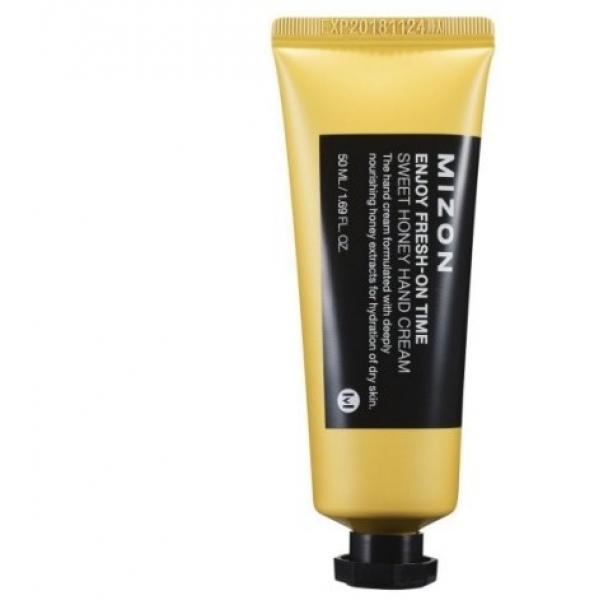 Mizon Sweet Honey Hand CreamРоскошный крем для рук на основе меда от Mizon позволит восстановить и сделать такой красивой даже самую сухую и обветренную кожу! Он имеет достаточно плотную текстуру, которая обволакивает эпидермис, насыщая каждую его клеточку полезными веществами. Оздоравливающее действие крема на кожу обеспечивается благодаря его богатейшему составу, содержащему множество ценных ингредиентов. Вытяжка меда является основным компонентом состава продукта, благодаря чему он интенсивно напитывает, смягчает и восстанавливает кожу. Наличие в формуле крема таких веществ, как березовый сок, масло карите и гиалуроновая кислота делает его еще более эффективным! Березовый сок обладает энергетизирующим и омолаживающим действием. Масло карите делает кожу удивительно мягкой и гладкой. Гиалуроновая кислота насыщает эпидермис влагой на длительное время. Такой продукт является идеальным для ухода за обезвоженной кожей рук и позволит им придать необычайную ухоженность, мягкость и нежность, защищая от действия различных погодных условий. Побалуйте ваши ручки роскошным восстанавливающим уходом, используя медовый крем от бренда Mizon!<br><br>&amp;nbsp;<br><br>Объём: 50 мл<br><br>&amp;nbsp;<br><br>Способ применения:<br><br>Средство рекомендуется наносить в любое время суток на очищенные и сухие кисти рук.<br>