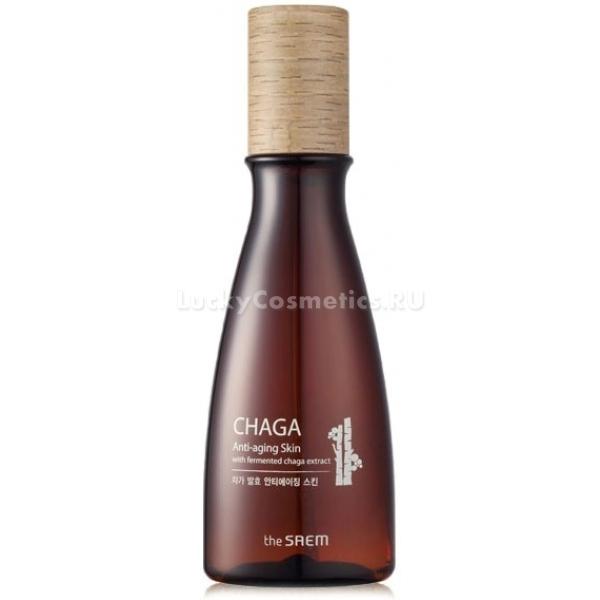 The Saem Chaga AntiWrinkle SkinАнтивозрастной флюид от компании The Saem разработан на основе удивительных омолаживающий свойств дикорастущего березового гриба. Он насыщает кожу живительной влагой, витаминами и микроэлементами. Регулярное использование флюида в уходе за лицом позволит за короткий промежуток времени оценить его яркий омолаживающий эффект.<br><br>Флюид не только качественно питает кожу, также он отлично очищает ее поверхность от ороговевшего слоя. Это позволяет предотвратить появление воспалительных элементов, расширенных пор, комедонов.<br><br>В составе средства также можно увидеть сбалансированный комплекс других растительных компонентов. Они защищают кожу от обезвоживания, способствуют скорейшему восстановлению клеток, устраняют серость кожи и предотвращают дряблость.<br><br>Флюид усиливает кровообращение в клетках, что является важным условием для естественного омоложения кожи. После нанесения средства кожа приобретает упругость, тонус и естественный привлекательный цвет.<br><br>Флюидная консистенция продукта позволяет ему легко впитываться, не оставлять жирных пятен и блеска. Средство не закупоривает поры, поэтому может быть использовано обладателями чувствительной кожи.<br><br>&amp;nbsp;<br><br>Объём: 160 мл<br><br>&amp;nbsp;<br><br>Способ применения:<br><br>Небольшое количество флюида нанести на лицо с помощью ватного диска.<br>