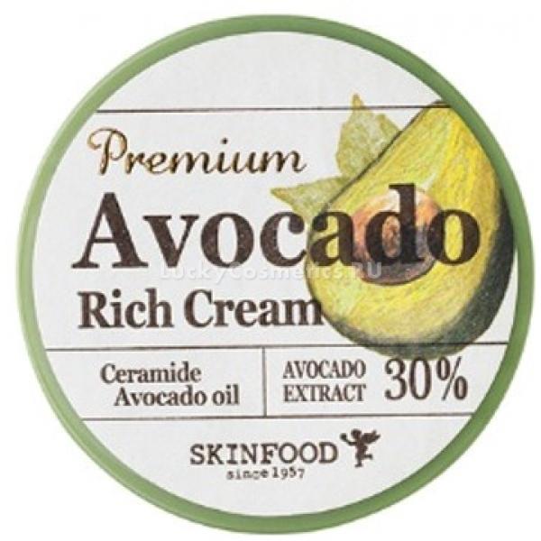 Skinfood Premium Avocado Rich CreamСухое и обветренное лицо доставляет немало проблем своей обладательнице – выглядит тускло, шелушится, плохо воспринимает макияж. Кроме всего прочего, обезвоженная кожа больше подвержена раннему старению и увяданию, а также не способна в полной мере обновляться. С регенерирующим кремом Premium Avocado эту ситуацию легко исправить, ведь он способен за кратчайшие сроки глубоко увлажить, напитать и изменить в лучшую сторону состояние эпидермиса.<br>Экстракт мякоти авокадо мгновенно насыщает полезными витаминами и микроэлементами кожу, активизируя защитные механизмы и позволяя ей самостоятельно восстанавливаться. Проникая глубоко внутрь, крем стимулирует выработку собственного коллагена, необходимого для борьбы с дряблостью и морщинами. Пользоваться им одно удовольствие благодаря нежному аромату и сливочной текстуре, которая моментально впитывается, оставляя эффект бархатистости и гладкости.<br>В основе формулы также лежат керамиды, незаменимые помощники при покраснениях и раздражениях. Они блокируют воспалительные процессы, сводят на нет неприятнее ощущения на коже, сглаживают шелушения, а также способны предотвратить появление пигментации и слегка осветлить уже имеющуюся.Объём: 78 мл.Способ применения:Тонким равномерным слоем нанести продукт на проблемные участки кожи или на все лицо при необходимости. Можно использовать как для утреннего, так и для вечернего ухода.<br>