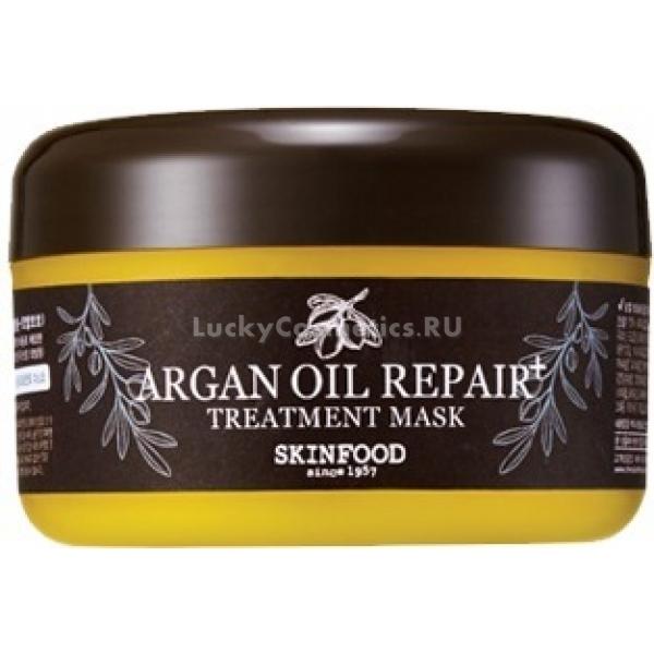 Skinfood Argan Oil Repair Treatment MaskСамая красивая прическа – это здоровые и ухоженные волосы. Для того, чтобы иметь густую шевелюру, необходимо глубокое питание и восстановление, ведь частое использование фена и плойки, окрашивания, погодные условия и неправильно подобранная косметика делают пряди безжизненными, ломкими, тусклыми.<br>Незаменимым SOS-средством в таком случае станет маска Argan Oil Repair+, основным действующим компонентом которой является жидкое золото – аргановое масло. Оно содержит в себе витамины А, Е и F, которые оказывают мощное антиоксидантное, противовоспалительное и увлажняющее воздействие, а также богато ненасыщенными жирами, способствующими процессам обновления и регенерации.<br>Реанимирующая маска для волос от Skinfood способна уже с первого применения визуально улучшить состояние шевелюры, сглаживания сечения, напитывая ломкие и сухие кончики, придавая длине здоровое сияние, шелковистость и упругость. Эффект держится до следующего мытья головы, ну а курс процедур способен творить чудеса – после регулярного использования продукта сухая «пакля» навсегда остается в прошлом!<br>В формуле присутствуют масла жожоба, сладкого миндаля, подсолнуха, кукурузы, которые способны обеспечить легкое расчесывание, термозащиту, гладкость без утяжеления. А еще Treatment Mask не содержит спирта, минерального масла, парабенов и отдушек, пагубно влияющих на состояние волос.Объём: 200 мл.Способ применения:Небольшое количество продукта нанести на предварительно вымытые и слегка подсушенные полотенцем волосы, распределить по всей длине, уделив особенное внимание кончикам. Через 10-15 минут смыть теплой водой и высйшить шевелюру естественным путем.<br>