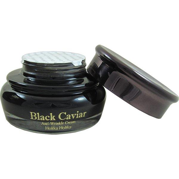 Holika Holika Black Caviar AntiWrinkle CreamЭтот крем дает зрелой коже весь спектр питательных веществ и энергии. Вытяжка из черной икры дружит с кожей, поэтому хорошо впитывается и питает даже самые глубокие слои кожи. Насыщенный эфирами жирных кислот, крем способствует активному синтезу коллагена, а питательные вещества икры замедляют процессы старения, выравнивают морщинки и делают кожу более молодой и упругой. Ионы золота способствую лучшему проникновению активных веществ в кожу, а бриллиантовая пыль разглаживает ее, дарит сияние и свежесть молодости. В составе крема также есть облепиховый и медовый экстракты, аргановое масло.<br><br>Крем одновременно решает несколько задач: сокращает количество морщин и их глубину, замедляет старение кожи, питает ее, восстанавливает эластичность и упругость. Подходит для всех типов кожи 40+.<br><br>&amp;nbsp;<br><br>Объём: 50 мл<br><br>&amp;nbsp;<br><br>Способ применения:<br><br>Нанести крем похлопывающими движениями на очищенную кожу лица и шеи. Чтобы не допустить растяжения кожи, наносите крем по массажным линиям.<br>