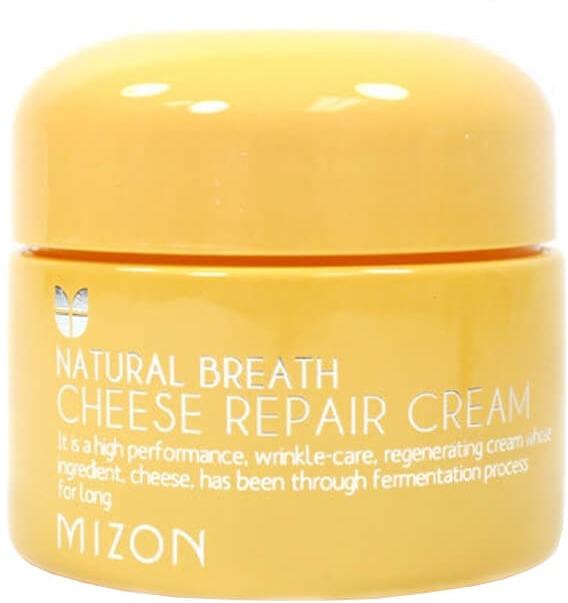 Mizon Cheese Repair CreamCheese Repair Cream &amp;ndash; новейший продукт, производящийся с помощью биотехнологий. Секрет изготовления сырного крема содержится в молочнокислых бактериях, которые при длительном брожении исходного продукта начинают выделять целый комплекс активных белков и ферментов, которые и являются ключевым компонентом Cheese Repair Cream от Mizon.<br><br>Естественные активные вещества делают сырный крем питательным и пригодным для эффективного впитывания в кожу, где сразу же начинается стимуляция обменных процессов, что способствует быстрому заживлению, высвобождению скрытых жизненных сил клеток. При регулярном использовании Cheese Cream кожа надолго станет свежей, здоровой и сильной в борьбе за свою красоту.<br><br>Негативные факторы окружающей среды, дефицит витаминов, сухость и нездоровый цвет лица &amp;ndash; обо всем этом можно забыть с Cheese Repair Cream. Сырные ферменты стимулируют кожу любого возраста и типа, так как являются натуральным органическим продуктом.<br><br>Схема оздоровления кожи<br><br>С момента попадания Cheese Repair Cream на вашу кожу сырные ферменты проникают в верхние слои эпидермиса и ускоряют метаболизм в клетках, что способствует транспортировке вспомогательных ингредиентов через мембраны. В итоге разогнанные ферментом эпителиоциты начинают с высокой скоростью поглощать и использовать:<br><br><br>Витаминный комплекс: ацетат токоферола, ниацинамид, оскорбил пальмитат, бета-каротины и многие другие;<br>Аденозин &amp;ndash; стимулятор деления клеток и синтеза белков кожного матрикса;<br>Аллантоин &amp;ndash; регенерирующий фактор;<br>Диметикон &amp;ndash; расслабляющее и успокаивающее раздражения средство;<br>Гиалуроновую кислоту &amp;ndash; природный накопитель влаги;<br>Экстракт барбарисового корня &amp;ndash; снимает отечность и покраснения;<br>Экстракт какао &amp;ndash; тонизирует кровеносную систему;<br>Экстракт плодов граната &amp;ndash; натуральный отбеливатель.<br><br><br>&amp;nbsp;<br><br>Объём: 50 мл<br><br>&a