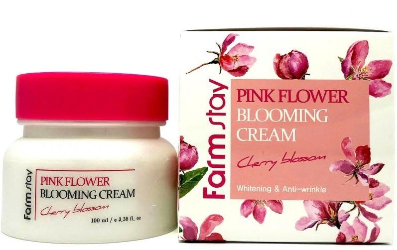 Farmstay Pink Flower Blooming Cream Cherry BlossomКомплексный уход за нежной кожей лица обеспечит крем Pink Flower Blooming Cream Cherry Blossom от корейского бренда Farmstay. Активная восстанавливающая формула мгновенно питает, увлажняет и снимает воспаления. Помогает контролировать работу сальных желез, укрепляет тонкую кожу, предотвращает появление сухости и шелушений. Легкая формула впитывается без остатка и помогает защитить нежные участки тела от агрессивного действия факторов окружающей среды и стрессов. Специальная формула борется с первыми признаками возрастных перемен, заполняет и разглаживает морщины, усиливает клеточное дыхание, выводит из клеток токсины, а также предотвращает раннее старение кожи.<br>Вишневый экстракт в составе средства эффективно устраняет сухость, укрепляет тонкие сосуды, регулирует процессы газообмена в клетках и дарит коже гладкость.<br>Ниацинамид основной компонент в борьбе за ровный тон. Он помогает деликатно отбеливать пигментацию, заполняет и разглаживает морщины, сужает расширенные поры и дарит коже упругость и свежий вид.<br>Розовая вода обеспечивает пролонгированный эффект увлажнения, защищает клетки от разрушения агрессивным солнечным излучением, свободными радикалами и процессами окисления. Смягчает грубые участки кожи, дарит ей упругость и эластичность.Объём: 100 мл.Способ применения:В завершающем этапе ухода нанесите необходимое количество средства на кожу лица и распределите до впитывания. Можно использовать в качестве основы под макияж в зимний период.<br>