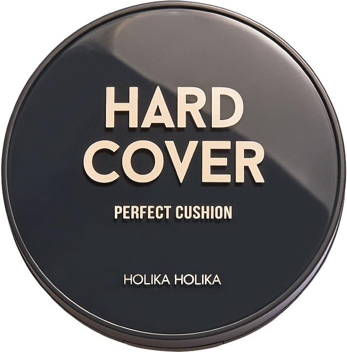 Holika Holika Hard Cover Perfect Cushion SetКомпактное маскирующее средство &amp;ndash; кушон от корейского бренда Holika Holika буквально произвела фурор на рынке мэйк &amp;ndash; индустрии. Средство не только прекрасно скрывает видимые недостатки, но и обладает терапевтическим эффектом.<br><br>Кушон Hard Cover Perfect Cushion обладает плотной текстурой, при этом не оставляет эффекта &amp;laquo;маски&amp;raquo;, ухаживает за кожей в течение дня и дарит ей легкость. Всего в два взмаха вы сможете замаскировать видимые рельефности, следы постакне и морщинки. А мерцающие пигменты устранят темные круги, обвисшую кожу или дряблость. Средство минимизирует негативное влияние ультрафиолета, стрессов и факторов окружающей среды. Кроме того, предотвращает образование свободных радикалов, прекрасно увлажняет сухую и подсушивает жирную кожу.<br><br>Экстракт корня солодки глубоко питает, увлажняет и снимает раздражение. Обеспечивает коже мягкость и гладкость.<br><br>Масло виноградных косточек усиливает клеточное дыхание, ускоряет обмен веществ и укрепляет стенки сосудов.<br><br>Экстракт лимона деликатно отбеливает, выравнивает цвет и предотвращает образование высыпаний.<br><br>&amp;nbsp;<br><br>Объём: 14 гр.<br><br>&amp;nbsp;<br><br>Способ применения:<br><br>При помощи спонжа наберите необходимое количество средства и нанесите на кожу, тщательно растушуйте.<br>